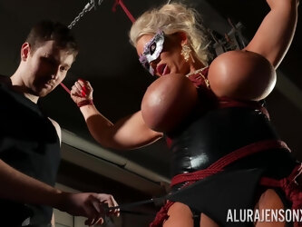 Bound cock slut Alura Jenson is toyed with by a stranger in a dungeon