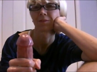 Hot mature mom giving a slow handjob to her hubby till cum