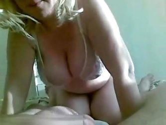 This is an amateur video of me with a hot blonde mature whore. She has huge tits under her sexy white bra, which made my dong really hard as she was g