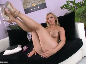 Arousing seductive blonde milf Tanya Tate with juicy knockers and whorish tattoo in high heels takes on undies and reveals her shaved fish lips in liv