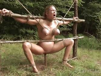It's clear that the blonde milf Rain is a city girl. Perhaps the fact that she's tied on that wooden structure and mouth fucked brutally in