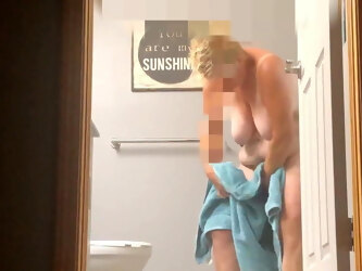 Mature with saggy tits showers