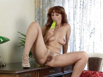knowing that we are patiently watching her every move Katja takes her time and slowly undresses. She feels horny and needs to fuck her cunt but first