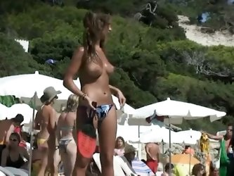 Big tits at the beach showing young or mature women sunbathing topless