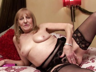 Hannah is a horny old lady who is playing with her body like a whore. See her undressing and showing her hot boobs to us. She squeeze those tits and t