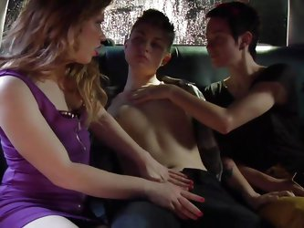 This boy has a very good day! He's on the backseat of a car, between two very sensual and hot chicks that are about to pleasure him beyond his dr