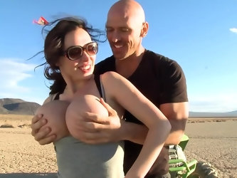 After driving their dune buggies through this desert, two lovers decided to stop for some fun. The MILF is hungry for the bald man's cock and she