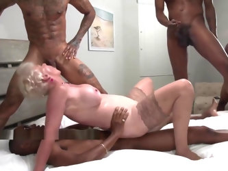 Blonde Granny enjoys double penetration during an Interracial Gangbang