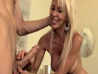 Insane oral and handjob by the mature mom