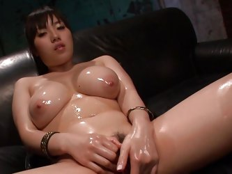 Oiled up and horny as hell the Asian chick demands a good hard fuck. She very aroused and keeps those hot thighs spread wide to rub her pussy until sh