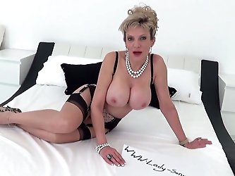 Blonde milf Lady Sonia playing with her sex toys