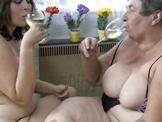 Big fat granny Eva and her younger girlfriend are having a good time together. Eva shows her younger bitch how it's done by rubbing her fat cunt