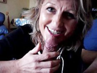 You gotta see this frisky slut in action as she is caught on webcam. This sexy mature slut just can't stop smiling for the camera as she sucks an