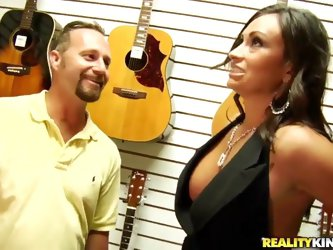 Hot girl with sexy boobies and really nice ass, is getting her tight jeans taken off and fucked nicely in the middle of the musical store by her new b
