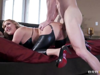 Pretty hot and sexy blonde chick Krissy Lynn in sexy leather bra and stockings bent over on bed at front of Johnny Sins, and he is tightly holding her
