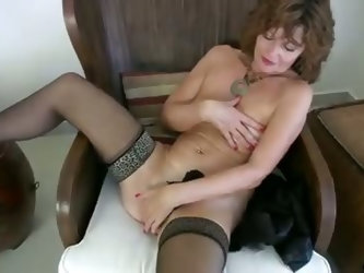 Milf strips out of tight leather, rubs her smooth naked