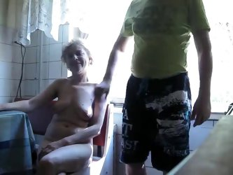 Mature smoking granny, naked and ready to be filmed gives her husband's a thug job till he shoots load on her sagging titties on video. Home porn