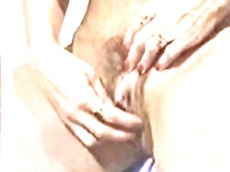 BUSTY MATURE PLAYS WITH HER BIG CLIT
