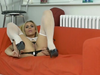 Flexible blonde model Brittany Bardot spreads her long legs to play
