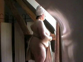 Nude in front of the window