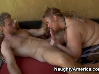 Milf Samantha professionally makes a blowjob with her enormously big hooters, she quaff a big dick of a young boy Levi. She likes this and then he lic