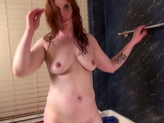 Sexy American Redhead Enjoys Her Toy In The Bathtub - MatureNL