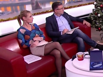 Long legged tv host in black pantyhose and heels 1
