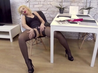 Zara wears high heels and stockings while playing with herself