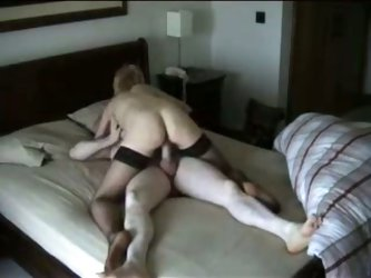 My neighbor's cheating wife got caught on camera when she met her boyfriend in this hotel room. Wearing just net-stockings, she fucks this guy's dick
