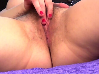 Video of round ass Nikita pleasuring her pussy on the purple sheets