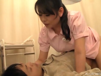 Busty nurse from Japan spreads her legs to ride a patient