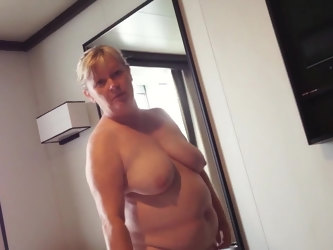 Horny wife undressing on cruise to reveal big tits and large belly
