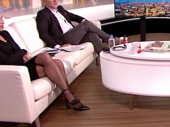 Long legged TV host in black pantyhose and heels 5