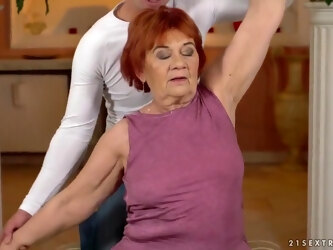 Red haired granny, Marsha is having wild sex with Rob, and enjoying it a lot