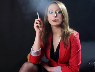 Elegant smoking by a refined woman