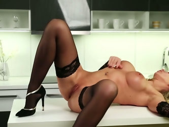 Stunning milf in sexy lingerie and stockings Queenie masturbates on the table