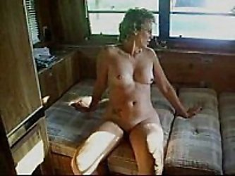 This swinger wife is in a camping resort, and sucks off another guy while her husband films.  She loves getting the semen from this guy's cock.