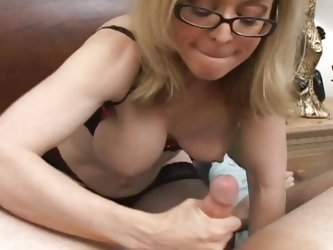 Anal loving MILF Nina Hartley parts her ass cheeks for a hard black cock