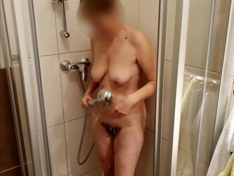 MILF shows mature tits, hairy cunt and big ass