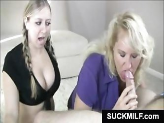 Mother and daughter takes turns chomping on his hard cock