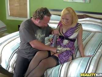 Arousing curvy blonde with curvy body figure in black lingerie and sexy summer dress seduces her old friend with goat beard and brings him home and ma