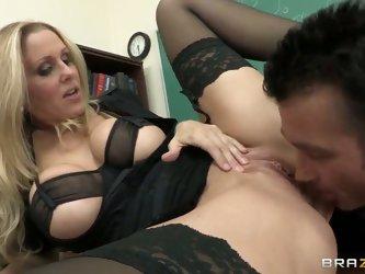 Sexy teacher Julia is sucking a big dick of her teacher and she like it very much. They were in the class when it all started and it was amazing blowj