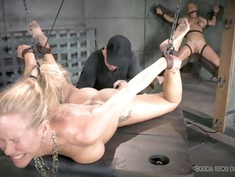 These scenes of real time bondage will definitely blow your mind! A blonde milf has been severely tied up with no possible chance to escape. While her