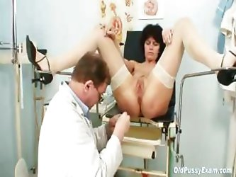 Mature brunette mom gets a very weird examination by doctor