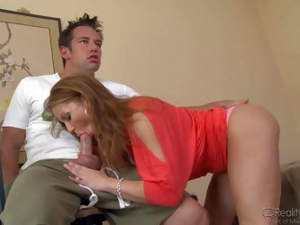 Inari Vachs is a good looking milf. Sexy woman takes off her red blouse and pink panties after giving headjob to hot boy. She lifts up her sexy legs a