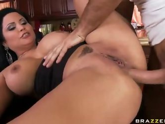 Busty brunette milf Sophia Lomeli loves young  handsome guys. She seduces one with her sexy massive titties to take his hard cock in her willing assho