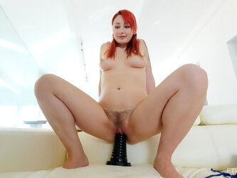 Violet drops her clothes to sit on a massive dildo and loves it