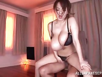 Hotomi is horny as fuck! She pulls off her sweater and reveals her massive breasts and then, she gets to work on riding some cock. Her boobs juggle as