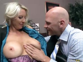 Big breasted office Emma Starr is a sexy lady that turns on Johnny Sins badly. He eats her big juicy tits and then her smooth experienced pussy with a