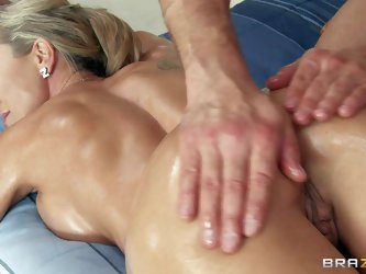 Brandi Love is a perfect bodied blond MILF with round ass and long legs. Naked amazingly sexy woman enjoys full body rub down and turns boy on. He lov